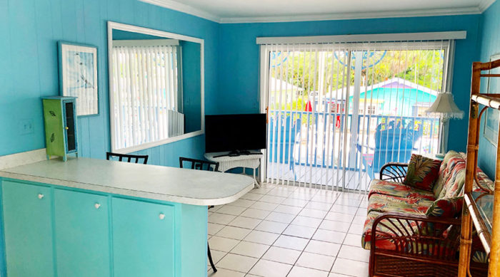 Lantana-Suite-kitchen-living-room-looking-out-to-balcony